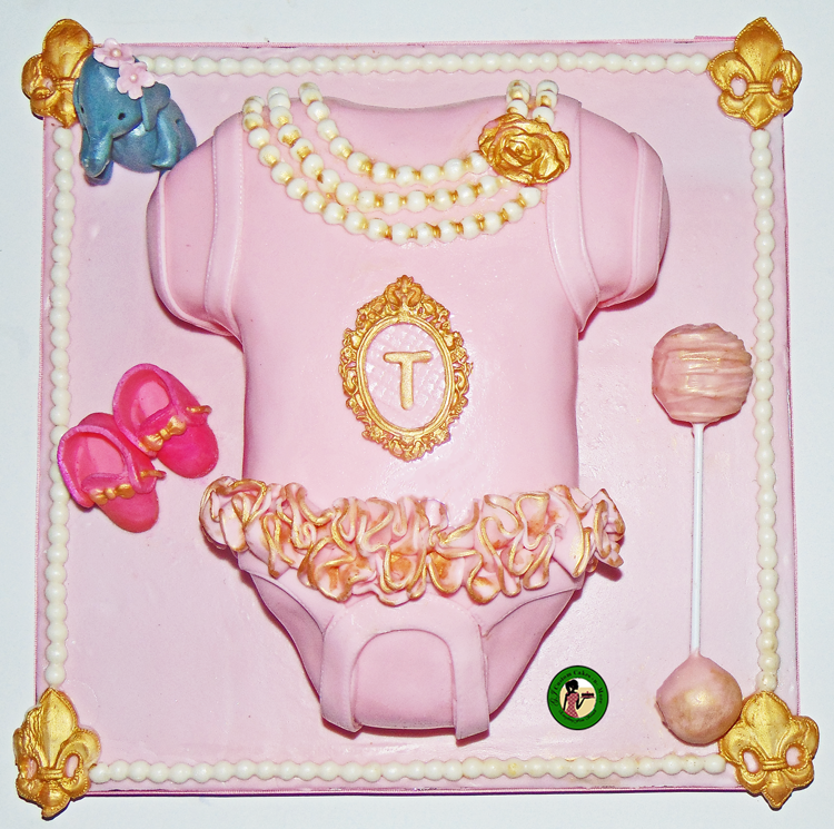 1459dc5ad Last week I made a princess baby onesie cake for my co-worker who is  expecting a baby girl. The baby onesie cake was complete with a cake pop  rattle, ...